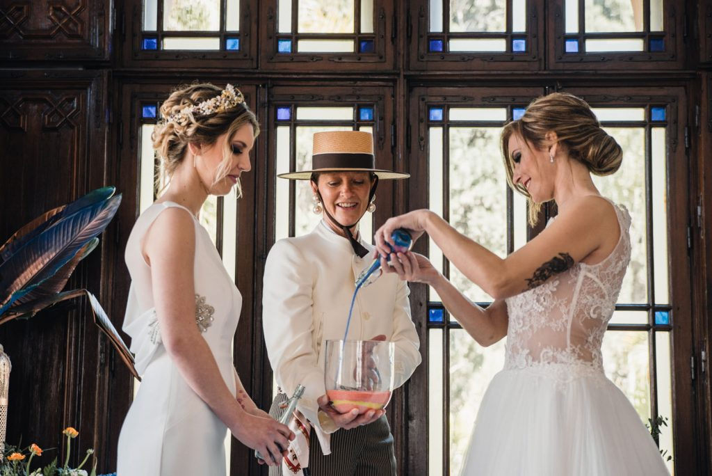 two brides get married in Spain with sand ceremony officiated by Celebrant Spain and photo Lara Jackson