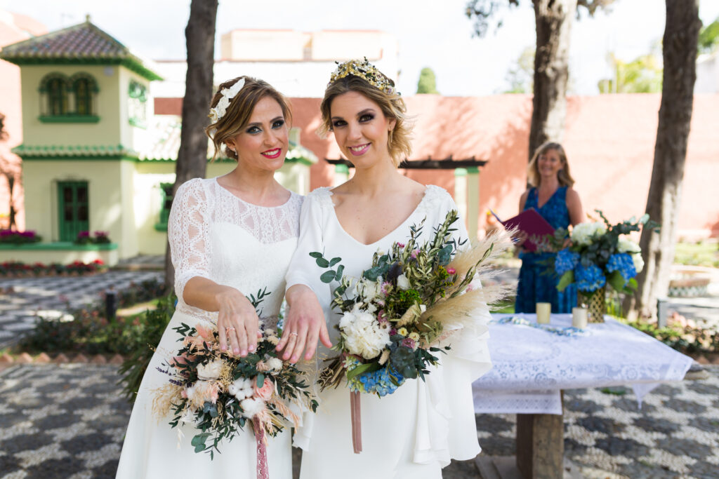 two brides wedding and engagement rings at Celebrant Spain ceremony