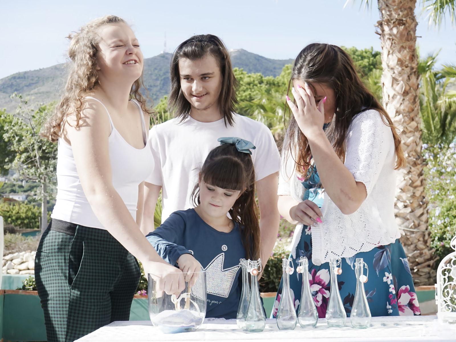Family unity ceremony at baby naming in Malaga Spain