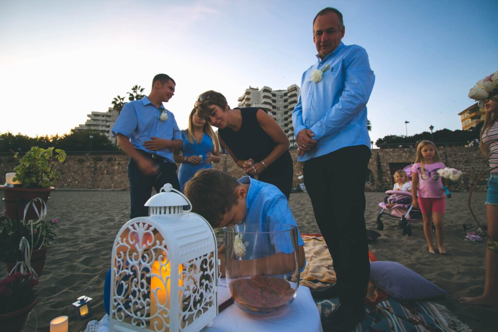 Candle ceremony on Malaga beach vow renewal